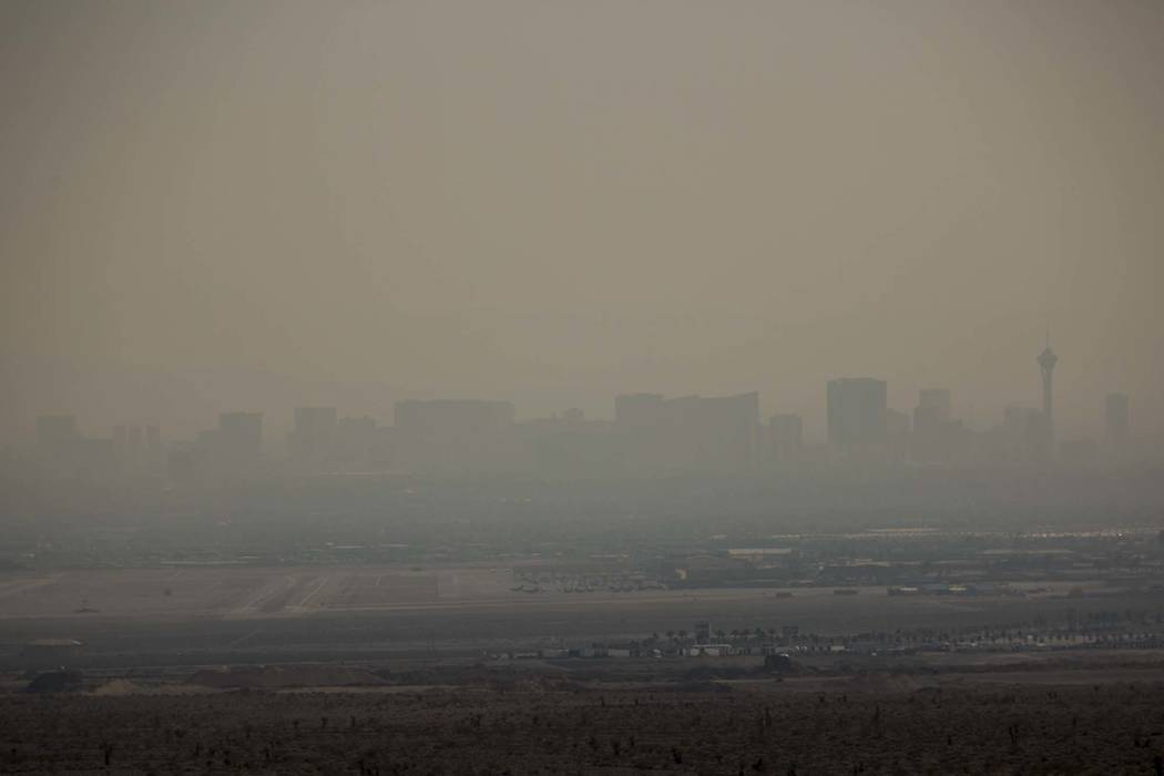 The Las Vegas Strip skyline is barely visible through a smoky haze as seen from Interstate 15 near Las Vegas Boulevard North, Sunday, Aug. 5, 2018. (Richard Brian/Las Vegas Review-Journal via AP)