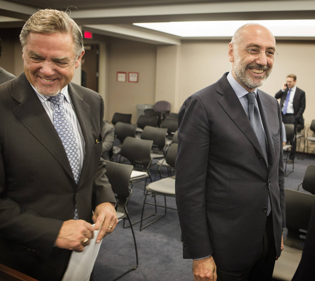 Phil Satre, left, International Game Technology chairman, and Marco Sala, CEO of GTECH Holdings, during a special Gaming Control Board hearing on Thursday, Feb 26, 2015. (Jeff Scheid/Las Vegas Rev ...