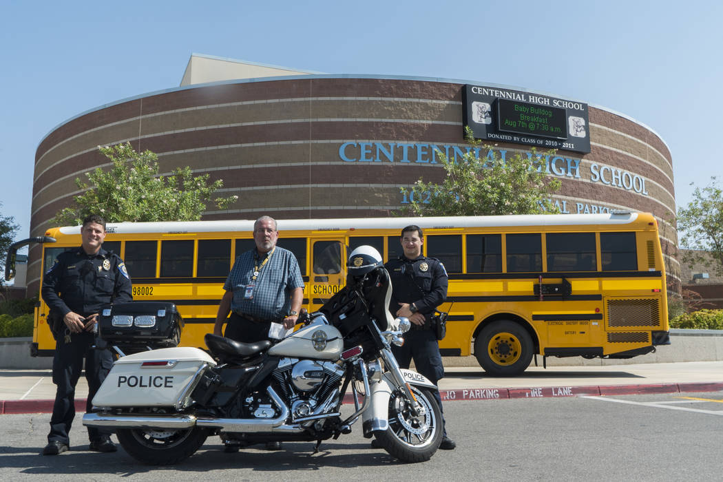 From left, officer Deuel, CCSD transportations manager Jim Reynolds and officer Pinto discuss student safety at Centennial High School in Las Vegas, Monday, Aug. 6, 2018. (Marcus Villagran/Las Veg ...