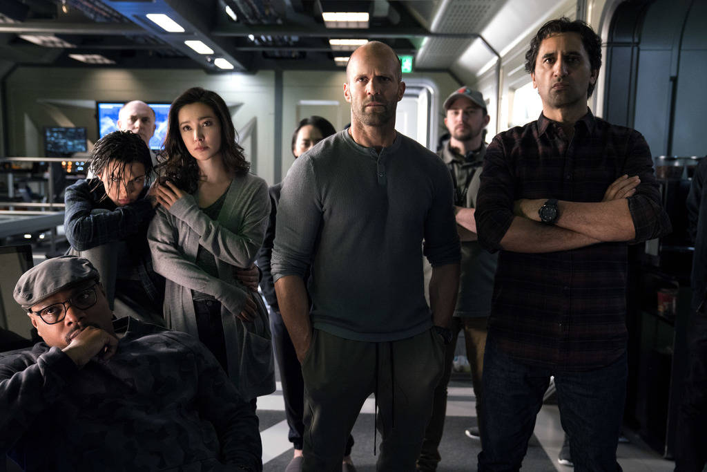 "This image released by Warner Bros. Entertainment shows, foreground from left, Page Kennedy, Ruby Rose, Li Bingbing, Jason Statham and Cliff Curtis in a scene from the film, ""The Meg."" ( ..."