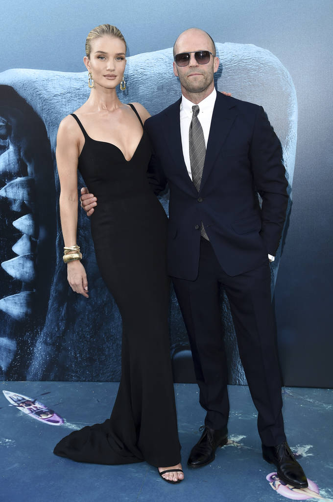 "Rosie Huntington-Whiteley, left, and Jason Statham attend the LA Premiere of ""The Meg"" at TCL Chinese Theatre on Monday, Aug. 6, 2018, in Los Angeles. (Photo by Richard Shotwell/Invision/AP)"