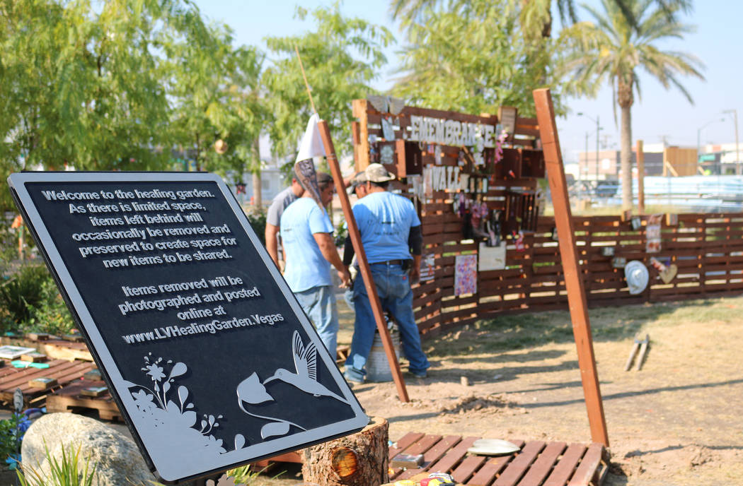 The Remembrance Wall at the Community Healing Garden in Las Vegas, Monday, Aug. 6, 2018. Crews moved the wooden wall to make way for construction on a permanent wall, set to begin within the week. ...