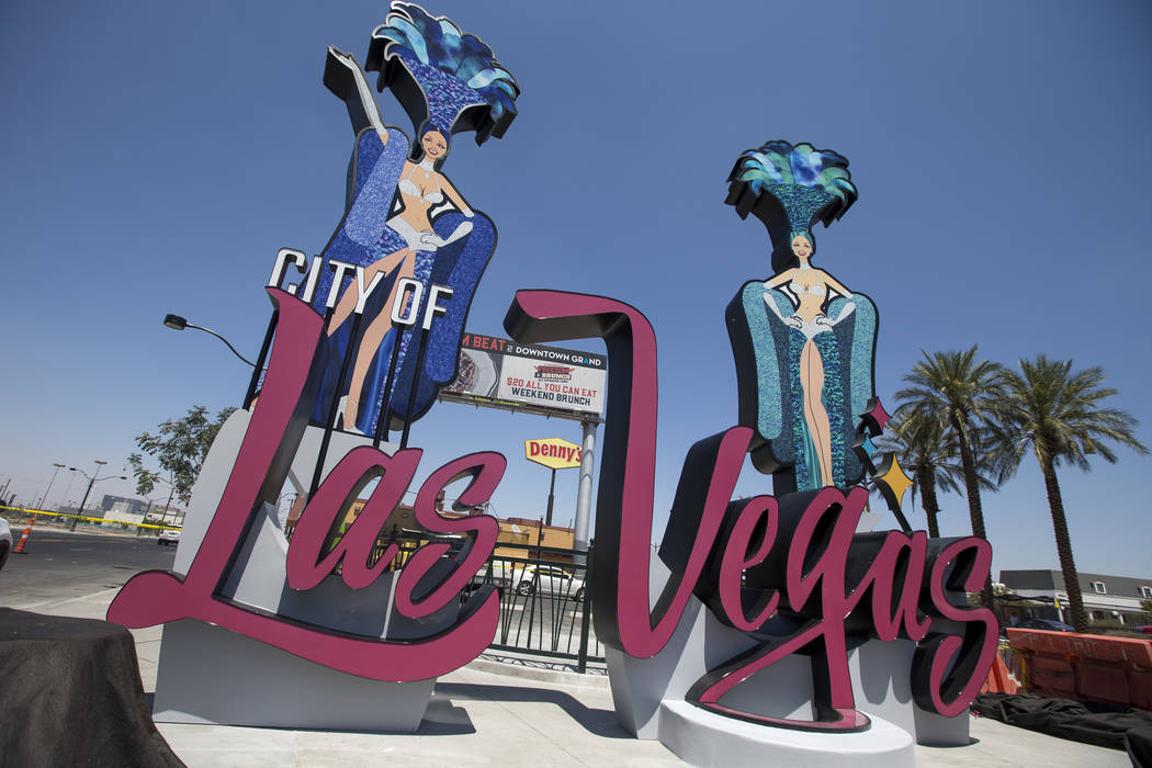 A new city of Las Vegas sign, complete with two showgirls and a roulette table, has been built at the corner of Las Vegas Boulevard and Main Street in downtown Las Vegas on Monday, Aug. 6, 2018. R ...