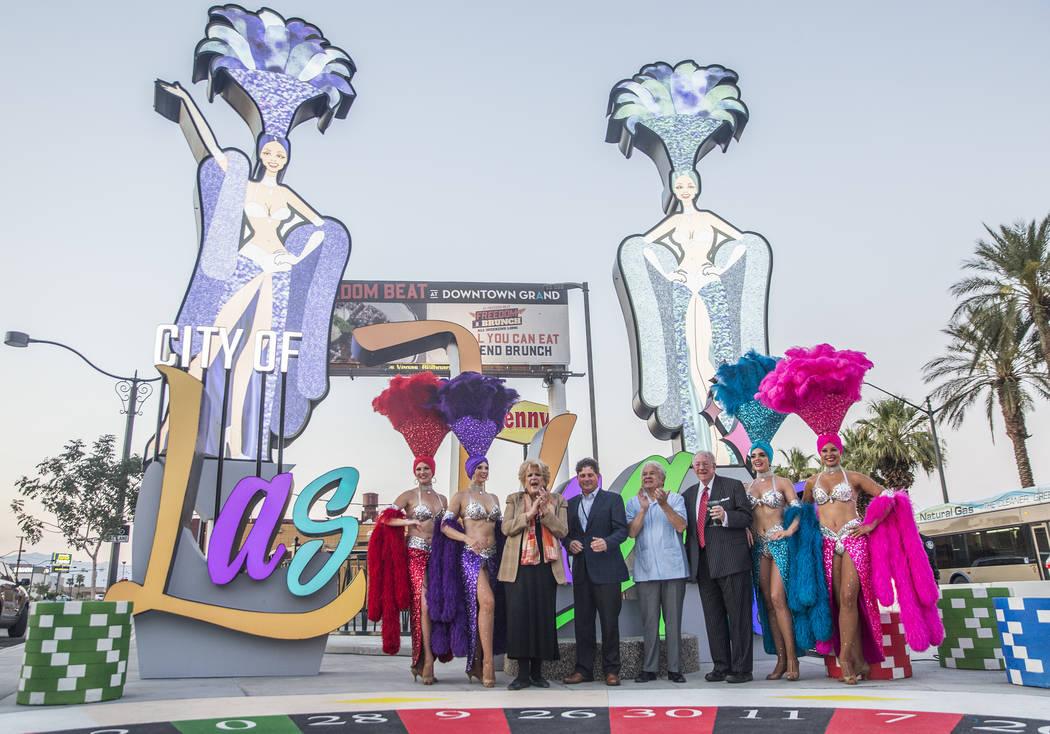 Las Vegas Mayor Carolyn Goodman, third from left, Chris Fiumara, vice president and general manager of the Stratosphere, Councilman Bob Coffin and former Las Vegas Mayor Oscar Goodman take photos ...