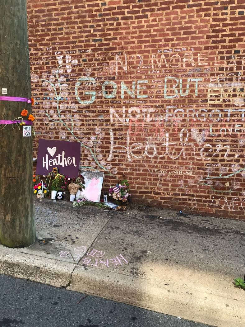 A makeshift memorial remains at the corner where Heather Heyer, a counter protester, was killed during a clash with white nationalists in Charlottesville, Virginia, a year ago. The city expects a ...