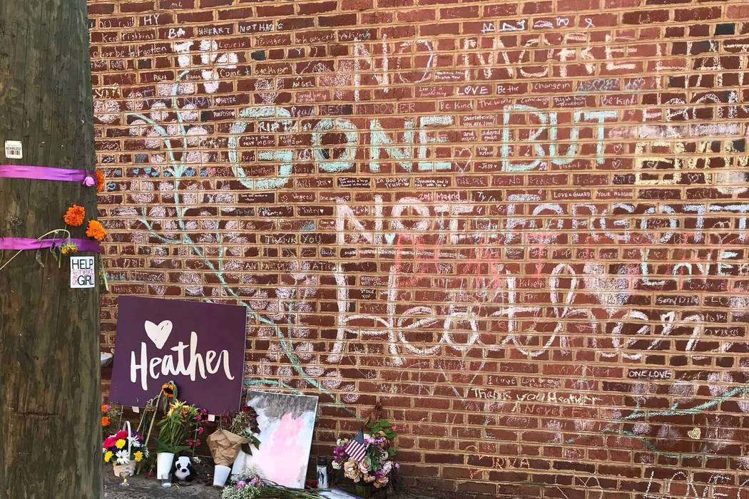 A makeshift memorial remains at the corner where Heather Heyer, a counter protester, was killed during a clash with white nationalists in Charlottesville, Virginia, on Aug. 12, 2017. The city expe ...