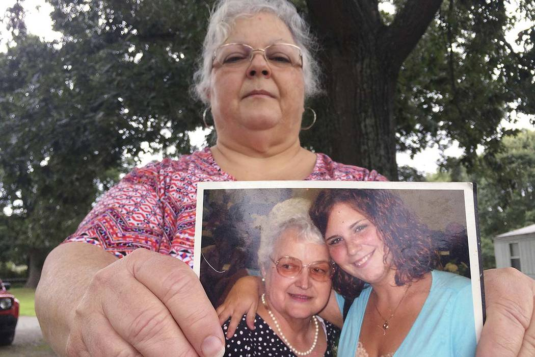 Susan Bro, the mother of Heather Heyer, holds a photo of her mother and Heather, Monday, Aug. 14, 2017, in Charlottesville, Virginia. (Joshua Replogle/AP)