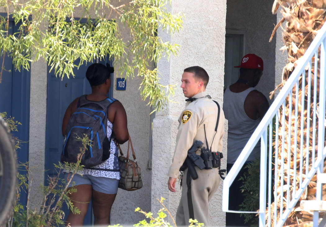 Residents at Kensington Suites in the 2200 block of West Bonanza Road watch as Las Vegas police are investigating an officer-involved shooting, Monday, Aug. 6, 2018. It's the third officer-involve ...
