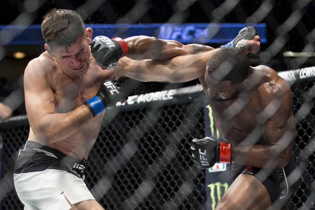 Demian Maia, left, battles Tyron Woodley in the welterweight title bout during UFC 214 at the Honda Center in Anaheim, Calif., on Saturday, July 29, 2017. Woodley won by unanimous decision. Erik V ...