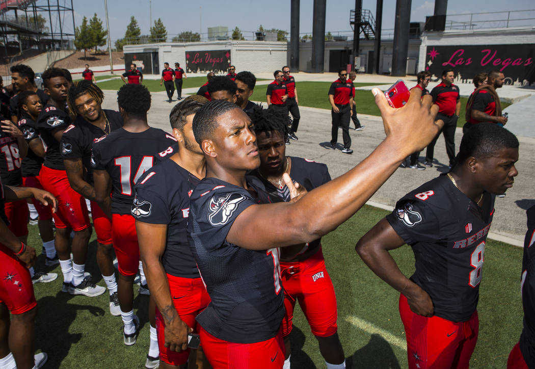 UNLV Rebels wide receiver Darren Woods Jr. (10) takes a selfie with wide receivers Drew Tejchman (11) and Tyleek Collins (9) during UNLV football's photo day at Sam Boyd Stadium in Las Vegas on We ...
