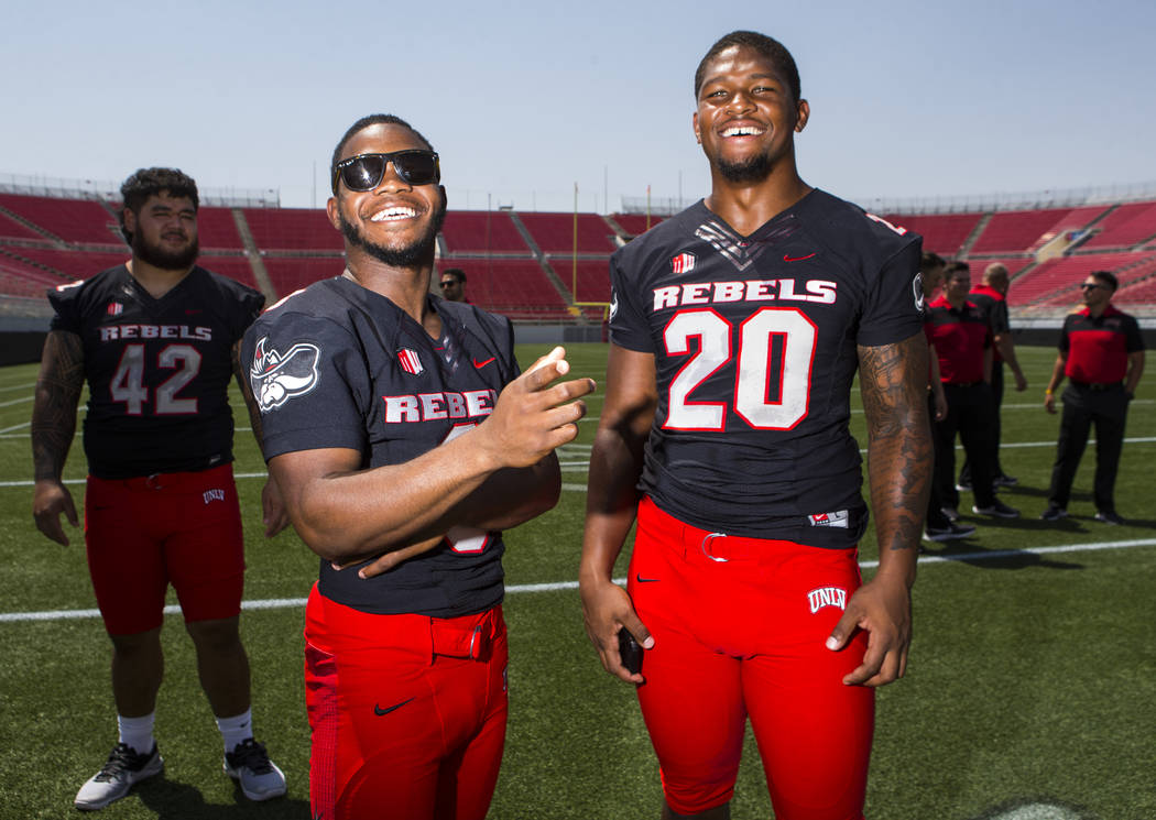 UNLV Rebels running back Lexington Thomas (3) and defensive lineman Jameer Outsey (20) pose for a photo during UNLV football's photo day at Sam Boyd Stadium in Las Vegas on Wednesday, Aug. 8, 2018 ...