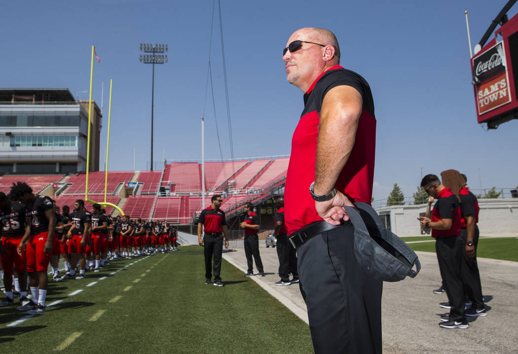 UNLV Rebels head coach Tony Sanchez watches his players during UNLV football's photo day at Sam Boyd Stadium in Las Vegas on Wednesday, Aug. 8, 2018. Chase Stevens Las Vegas Review-Journal @csstev ...