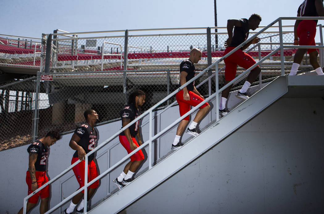 UNLV football players get into place during the team's photo day at Sam Boyd Stadium in Las Vegas on Wednesday, Aug. 8, 2018. Chase Stevens Las Vegas Review-Journal @csstevensphoto