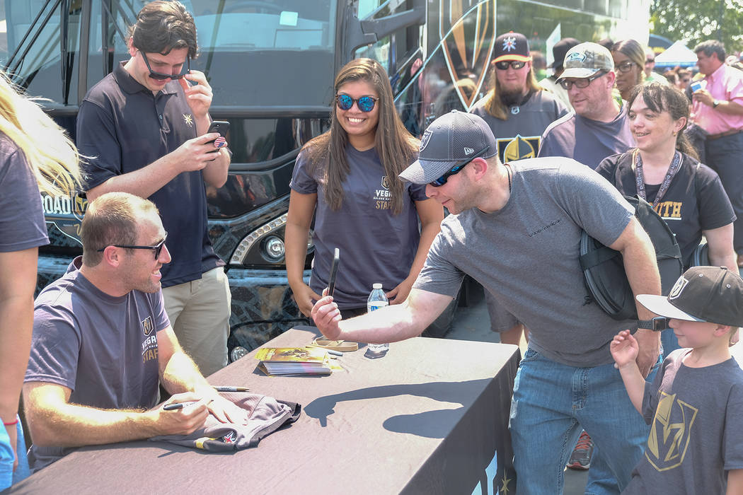 Eric Friedlander, 41, middle, and his son Everett, 5, chat with Vegas Golden Knights defenseman Brad Hunt at a fan rallyin Reno on Monday, August 6, 2018.Colton LochheadLas ...