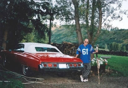 "Hunter S. Thompson is shown with his 1973 Chevrolet Caprice Classic, given to him by friends in 1991 to honor the ""Red Shark"" from ""Fear & Loathing in Las Vegas."" (Anita Thompson)"