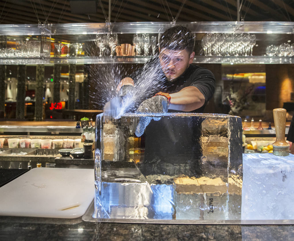 Barback Danny Padilla carves ice for a Japanese Old Fashion cocktail at Zuma on Monday, Aug., 6, 2018, at The Cosmopolitan of Las Vegas. Benjamin Hager Las Vegas Review-Journal @benjaminhphoto
