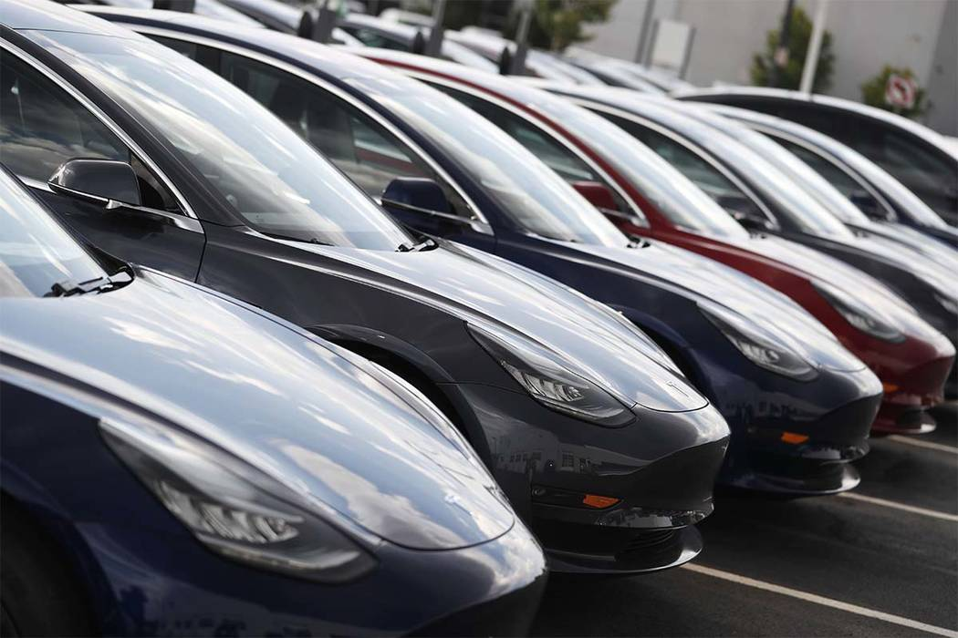 """In this Sunday, July 8, 2018, photograph, 2018 Model 3 sedans sit on display outside a Tesla showroom in Littleton, Colo. The Insurance Institute for Highway Safety, in a paper titled """"Reality C ..."""