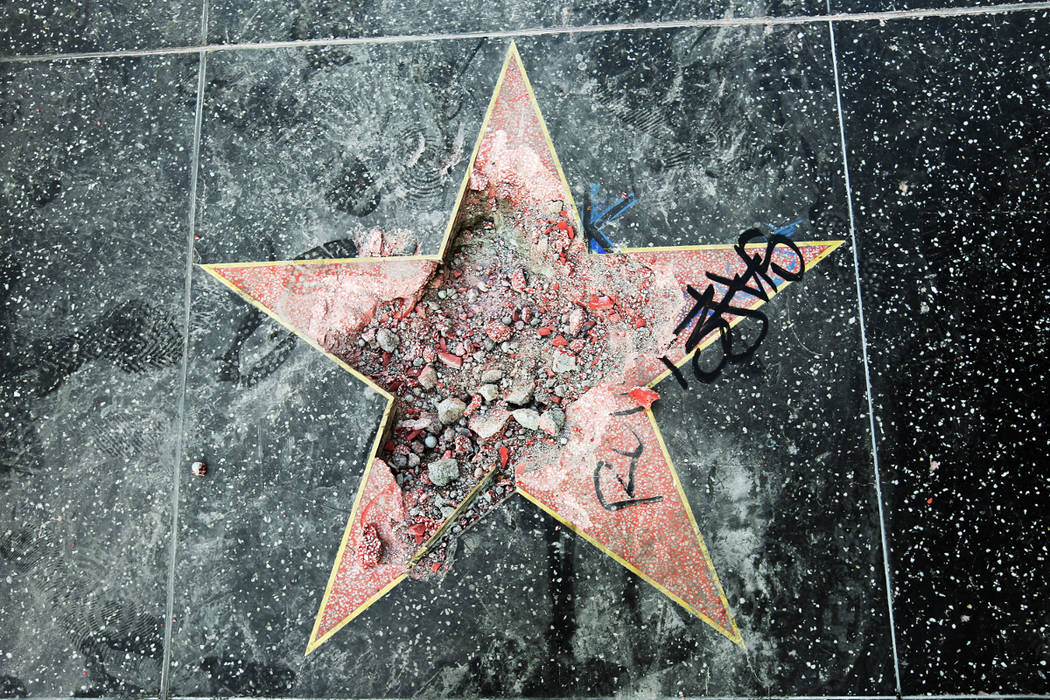 This photo shows Donald Trump's star on the Hollywood Walk of Fame that was vandalized Wednesday, July 25, 2018, in Los Angeles. Los Angeles police Officer Ray Brown said the vandalism was reporte ...