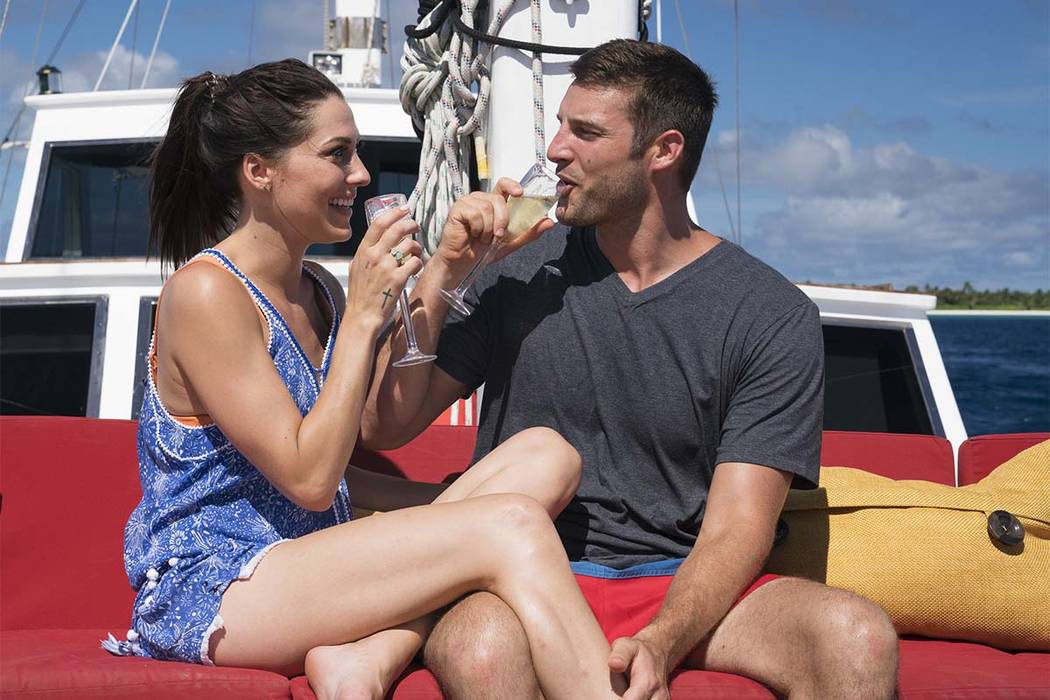"In this undated photo provided ABC, Becca Kufrin, left, drinks with Garrett Yrigoyen in an episode of the ""The Bachelorette."" Kufrin celebrated her engagement to Yrigoyen, capping the Monday, ..."
