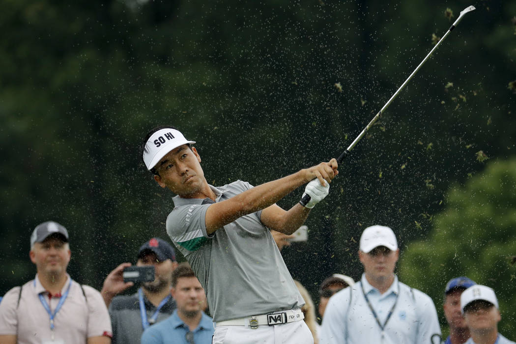 Kevin Na tees off on the second hole during a practice round for the PGA Championship golf tournament Tuesday, Aug. 7, 2018, at Bellerive Country Club in St. Louis. (AP Photo/Charlie Riedel)