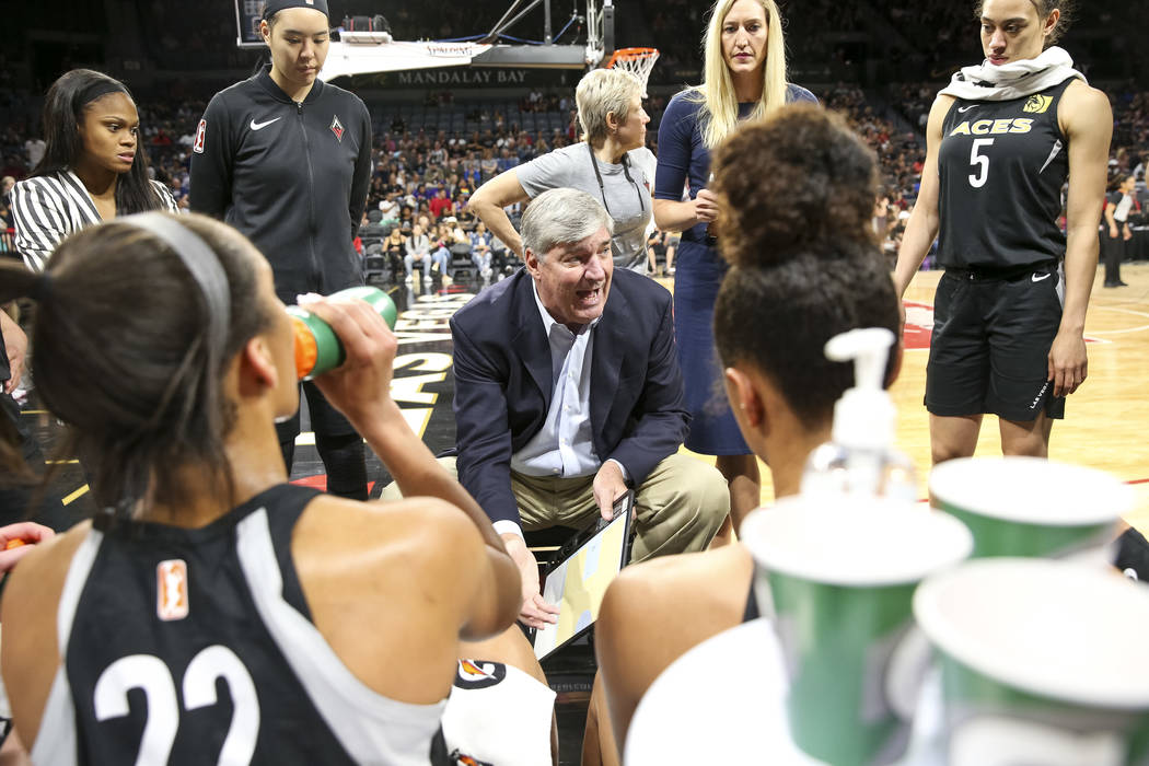 Las Vegas Aces head coach Bill Laimbeer, center, talks to his players during a time out against the Phoenix Mercury in the first half of a WNBA basketball game at the Mandalay Bay Events Center in ...