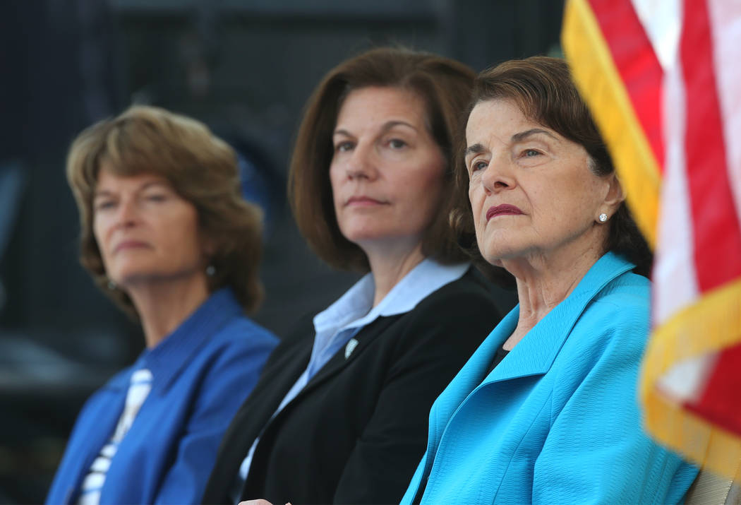 From left, U.S. Sens. Lisa Murkowski, R-Alaska, Catherine Cortez Masto, D-Nev., and Dianne Feinstein, D-Calif., listen to speakers at the 22nd annual Lake Tahoe Summit, at Sand Harbor State Park, ...