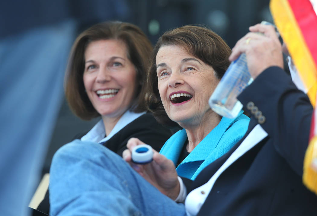 From left, U.S. Sens. Catherine Cortez Masto, D-Nev., and Dianne Feinstein, D-Calif., react to a speaker at the 22nd annual Lake Tahoe Summit, at Sand Harbor State Park, near Incline Village, Nev. ...