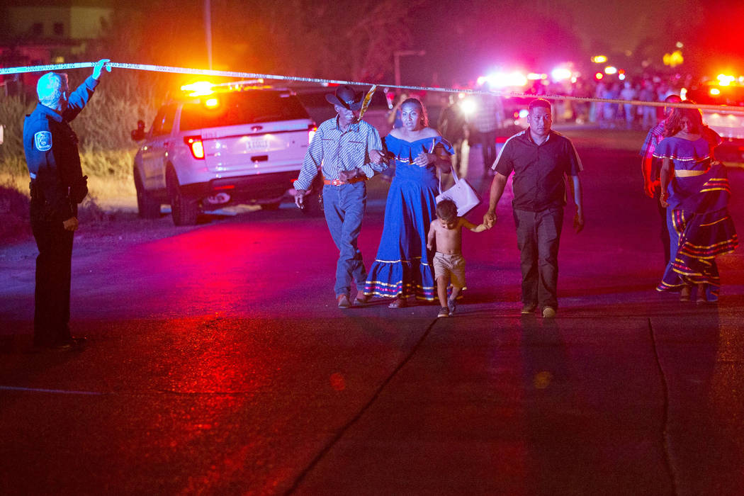 People leave the scene of a shooting that broke outside a party near Allen and Coran lanes in North Las Vegas on Saturday, Aug. 4, 2018. (Richard Brian Las Vegas Review-Journal @vegasphotograph)