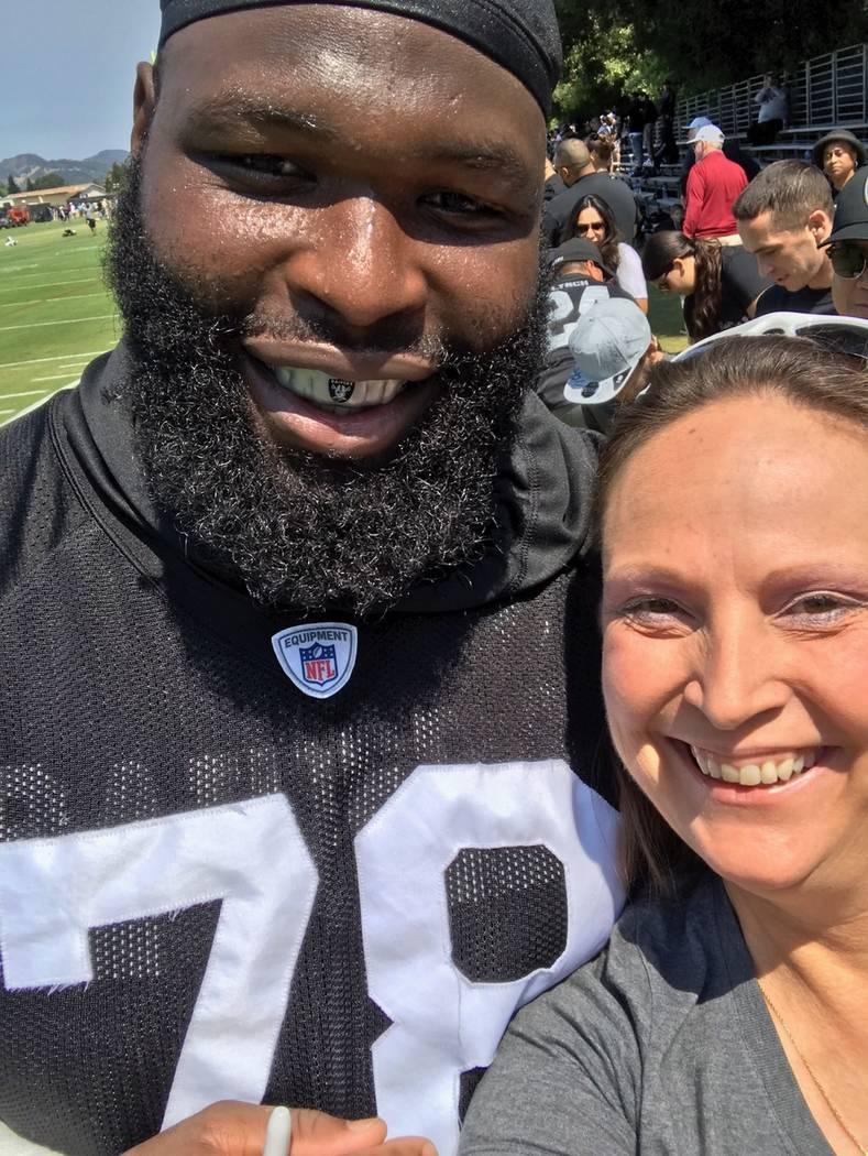 April Hiett poses with Oakland Raiders defensive tackle Justin Ellis. (April Hiett)