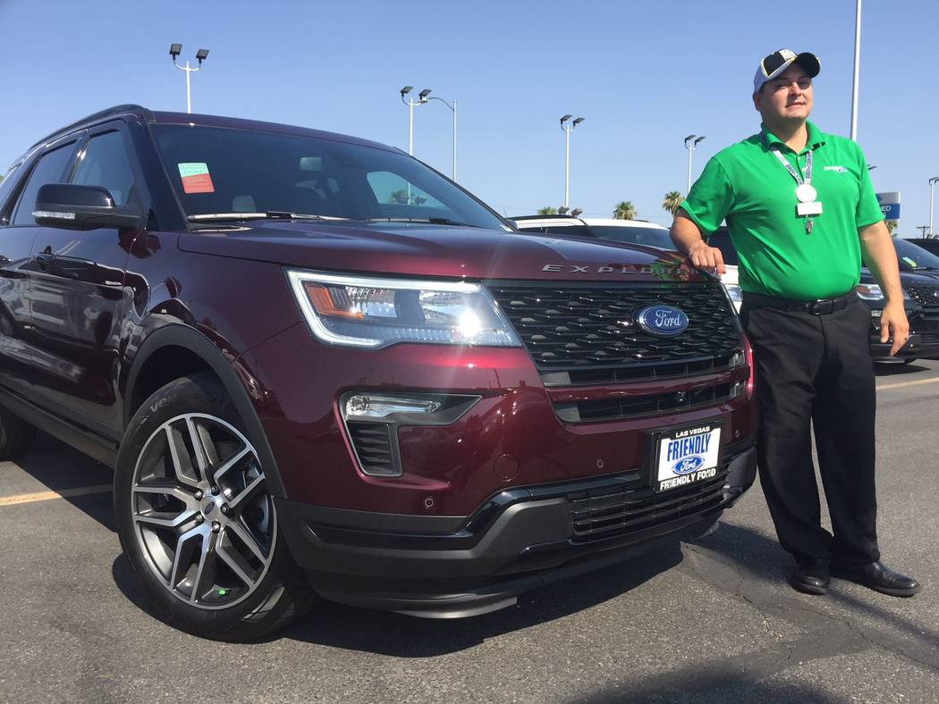 Friendly Ford sales consultant Joe Christensen is seen with a 2018 Ford Explorer sport utility vehicle at the dealership at 660 N. Decatur Blvd. (Friendly Ford)