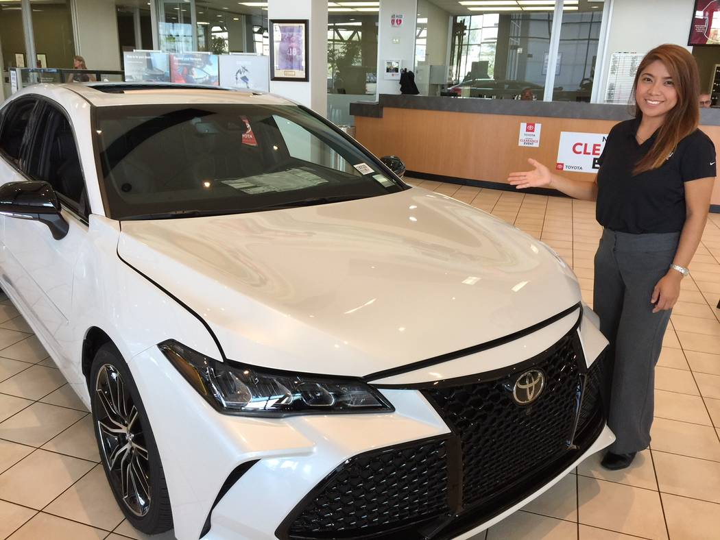 Findlay Toyota sales consultant Monaliza Pence is seen with a 2019 Toyota Avalon at the dealership at the Valley Automall in Henderson. (Findlay)