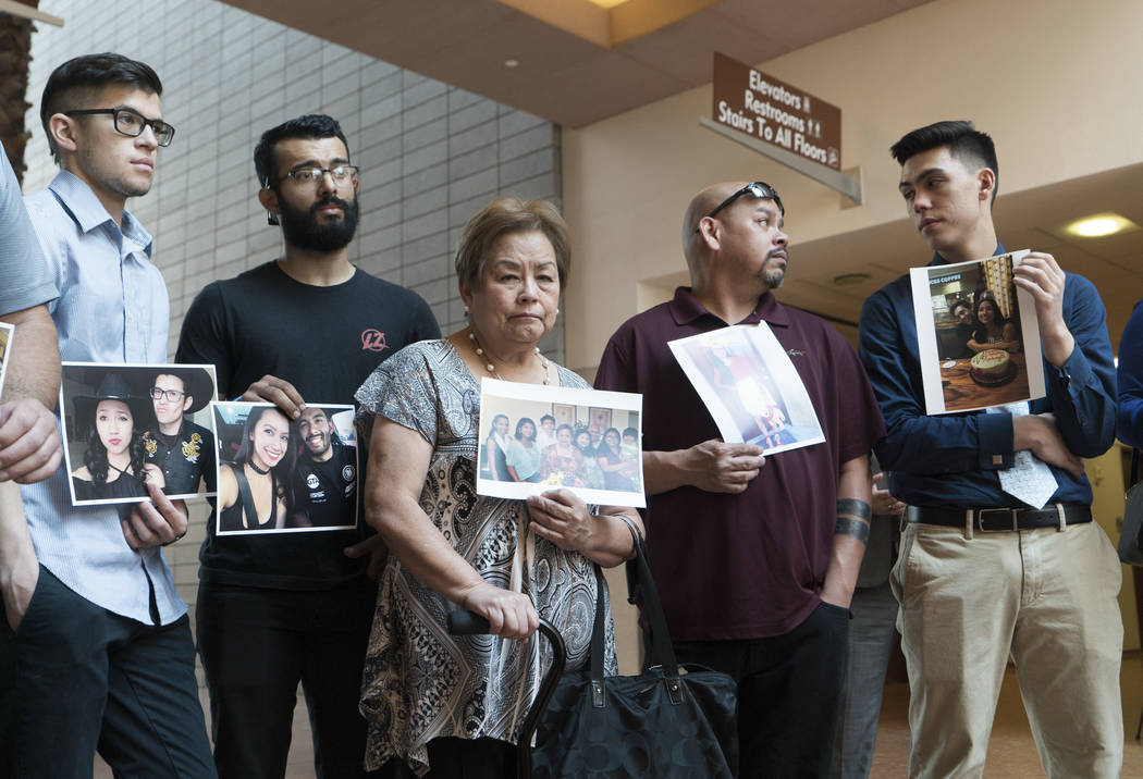 Ludmilla Pingol, center, grandmother of MaKayla Rhiner, is surrounded by family and friends as she holds up a photo of the Pingol family at the Regional Justice Center in Las Vegas on Tuesday, Au ...