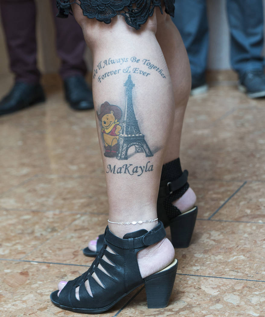 Lynn Pingol reveals a tattoo dedicated to her daughter, MaKayla Rhiner, at the Regional Justice Center in Las Vegas, Tuesday, Aug. 7, 2018. Brandon Hanson was sentenced to life in prison with poss ...
