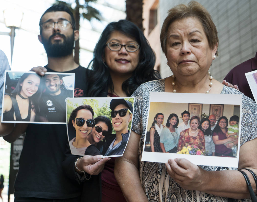 From left, Moises Duenas, ex-boyfriend of MaKayla Rhiner; Lynn Pingol, Rhiner's mother; and Ludmilla Pingol, Rhiner's grandmother, hold photos of Rhiner at the Regional Justice Center in Las Vega ...