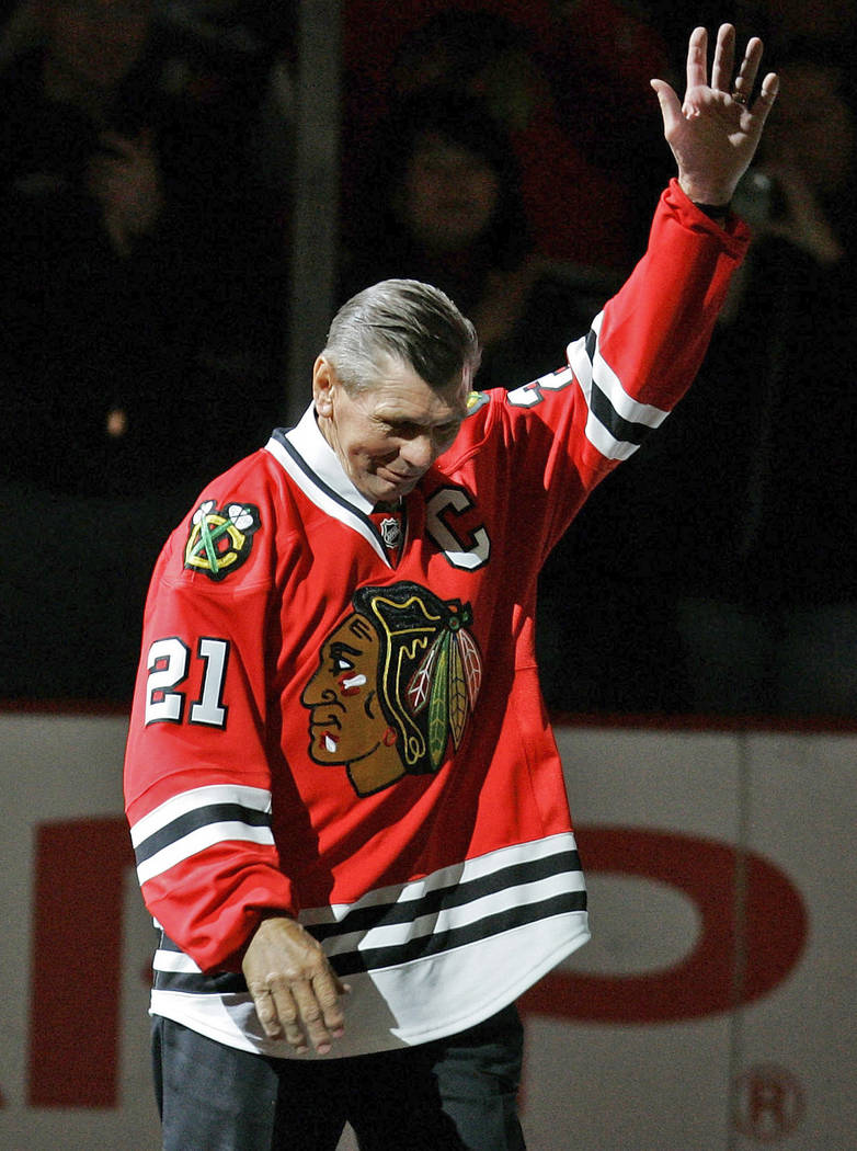 In this March 7, 2008, file photo, Chicago Blackhawks great Stan Mikita waves to fans as they as he is introduced before an NHL hockey game against the San Jose Sharks in Chicago. (AP Photo/Brian ...