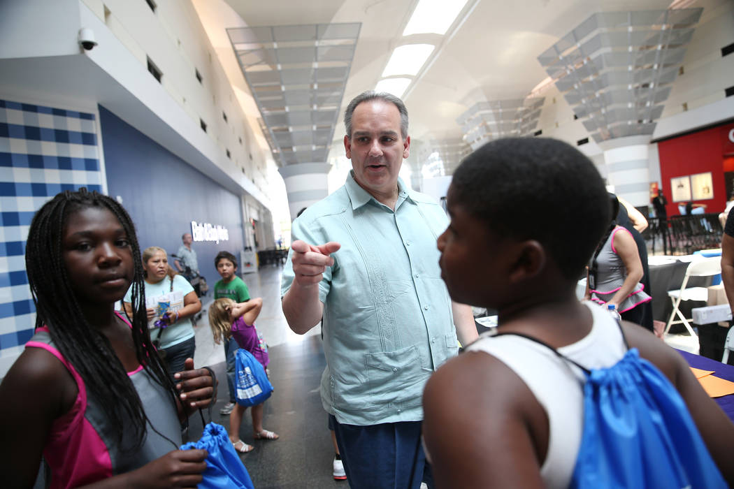 Markeisha Walker, left, 10, and her brother Jacory Watkins, 13, of Las Vegas, listen to CCSD Superintendent Jesus Jara during the annual Cox Back to School Fair at Boulevard Mall in Las Vegas, Sat ...