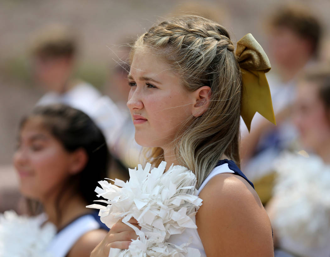 Boulder City High School cheerleaders listen to the National Anthem during a ceremony at the Interstate 11 overlook marking the opening of a 12.5 mile section of the freeway, also known as the Bou ...