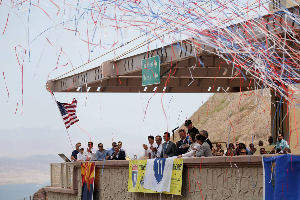 Elected officials and dignitaries unveil an Interstate 11 shield during a ceremony at the I-11 overlook marking the opening of a 12.5 mile section of the freeway, also known as the Boulder City By ...