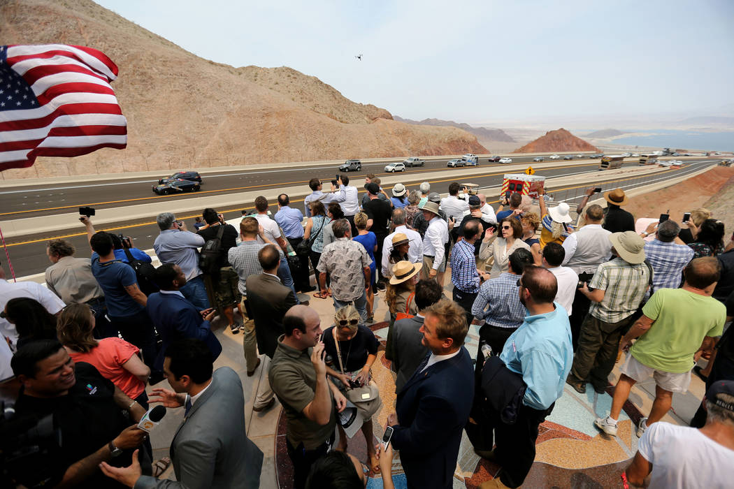 Nevada Highway Patrol troopers escort the first vehicles on Interstate 11 during a ceremony at the I-11 overlook marking the opening of a 12.5 mile section of the freeway, also known as the Boulde ...
