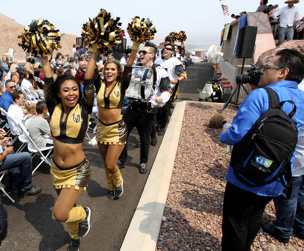 Vegas Golden Knights cheerleaders and Knight Line drum team during a ceremony at the Interstate 11 overlook marking the opening of a 12.5 mile section of the freeway, also known as the Boulder Cit ...