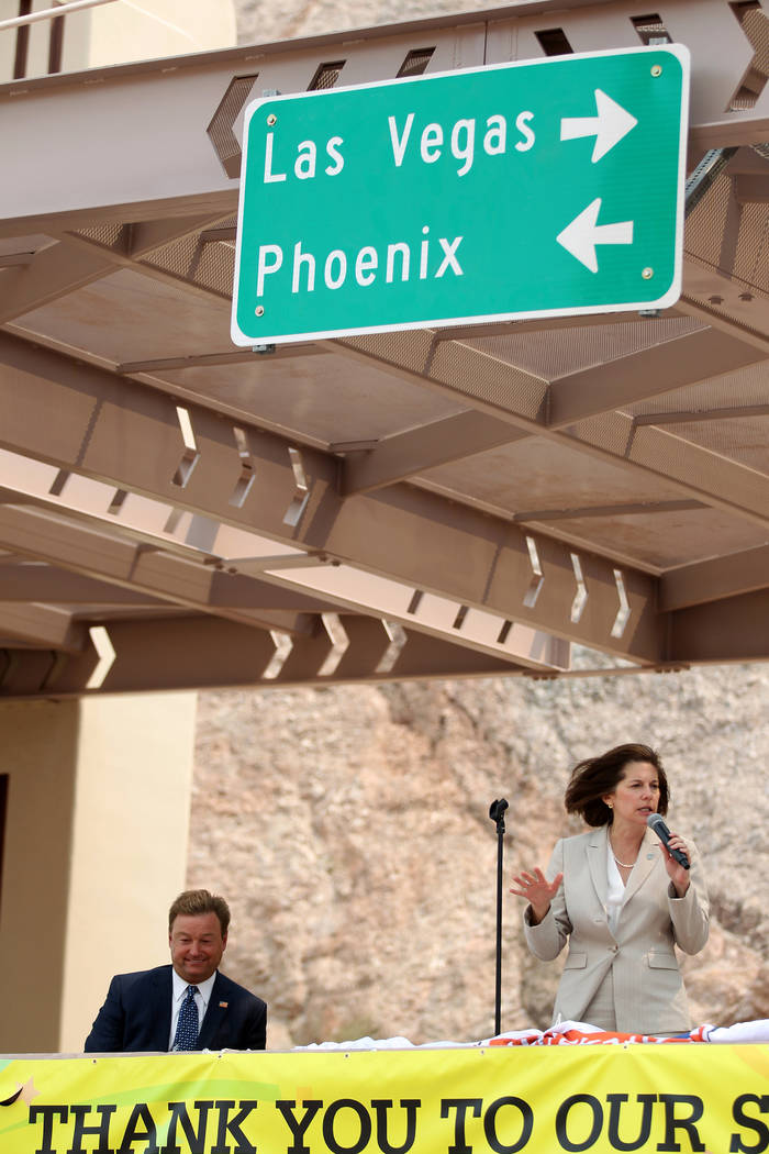 U.S. Sens. Dean Heller, R-Nev., listens as U.S. Sen. Catherine Cortez Masto, D-Nev., speaks during a ceremony at the Interstate 11 overlook marking the opening of a 12.5 mile section of the freewa ...