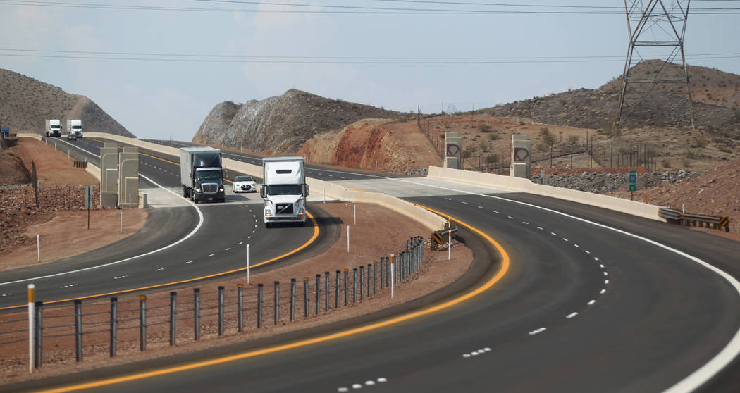 Traffic moves on the northbound lanes of Interstate 11 after a ceremony marking the opening of a 12.5 mile section of the freeway, also known as the Boulder City Bypass, Thursday, Aug. 9, 2018. Mo ...