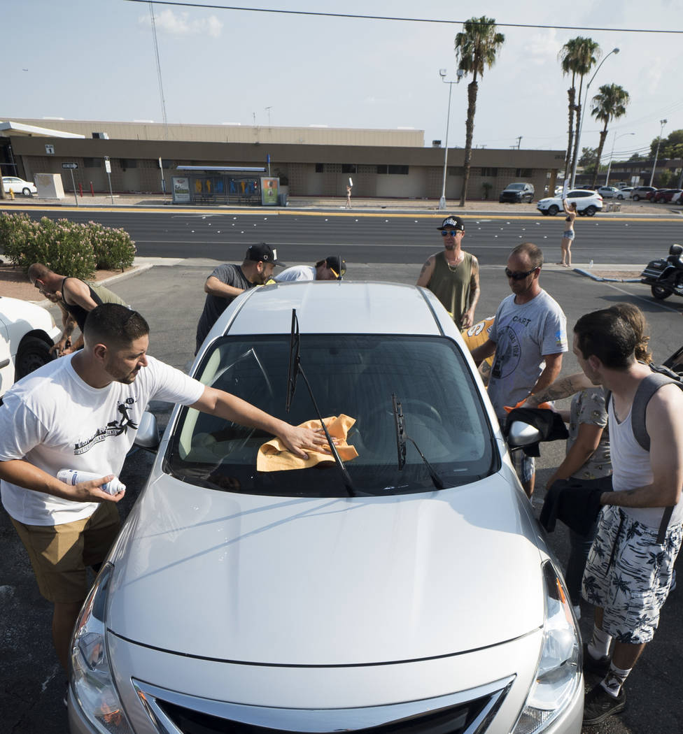 Friends and family of Brandon Steckler Jr. help raise money to pay funeral expenses for Brandon Steckler Jr. by running a car wash at The Drop in Las Vegas, Thursday, Aug. 9, 2018. Steckler Jr. di ...