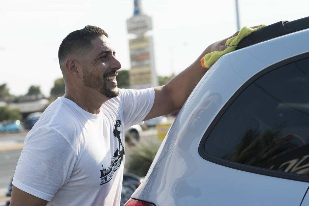 Joaquin Rivera, director at Veterans Walk and Talk Las Vegas, helps raise money to pay funeral expenses for Brandon Steckler Jr. at The Drop in Las Vegas, Thursday, Aug. 9, 2018. Steckler Jr. died ...