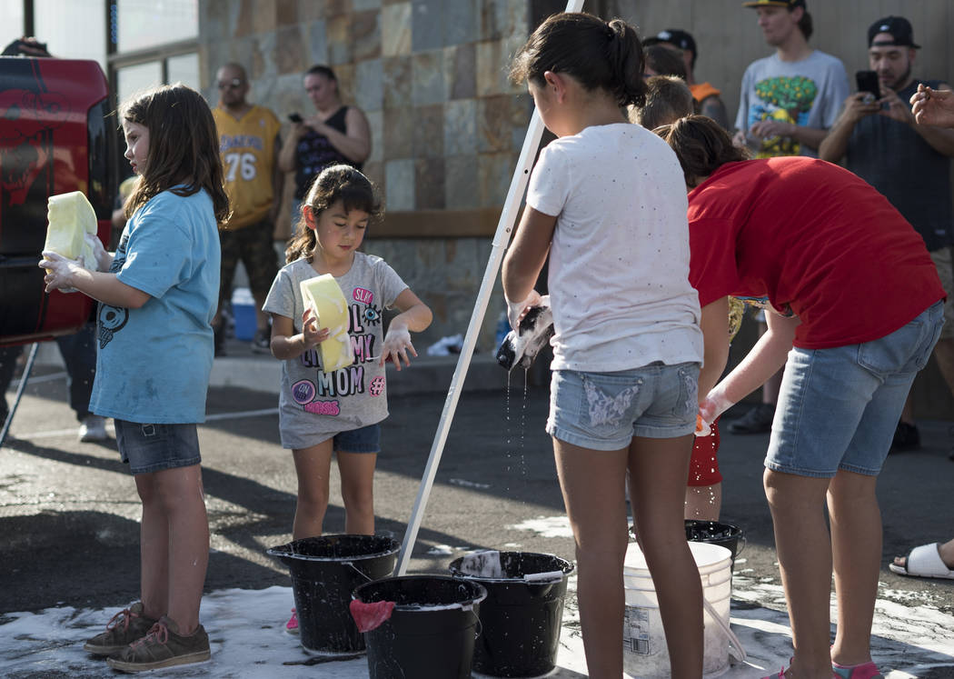Sallie Valtierra, 5, second from left, helps raise money to pay funeral expenses for Brandon Steckler Jr. at The Drop in Las Vegas, Thursday, Aug. 9, 2018. Steckler Jr. died in a severe child abus ...