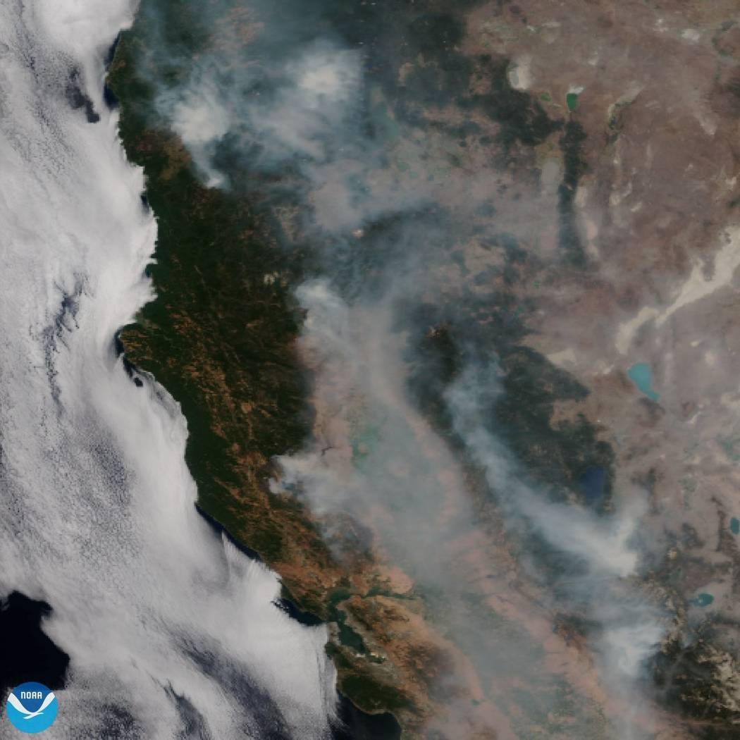 This satellite image released on Tuesday, Aug. 7, 2018 provided by NOAA shows the wildfires known as the Mendocino Complex, Calif. Northern California is grappling with the largest wildfire in Cal ...