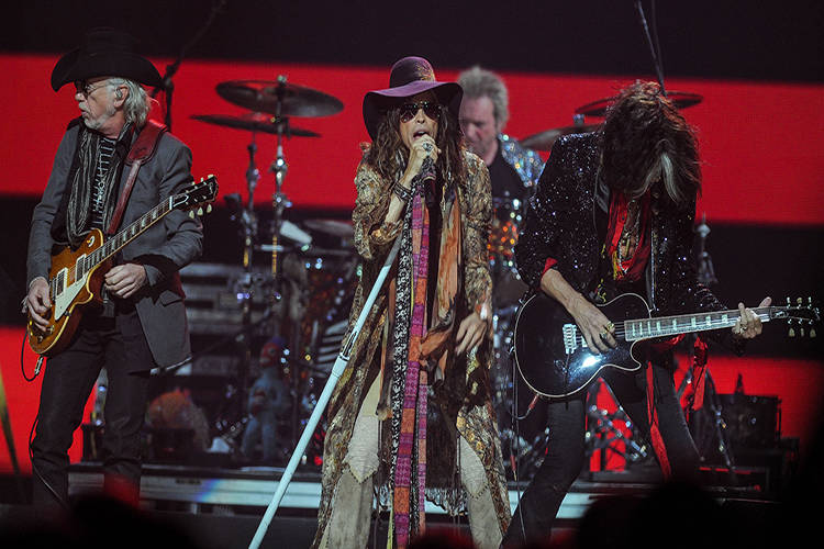 Steven Tyler sings with guitarist Joe Perry, right, and Brad Whiteford, left, of Aerosmith perform at iHeart Radio Music Festival on Saturday, Sept., 22, 2012 at the MGM Grand Arena in Las Vegas. ...