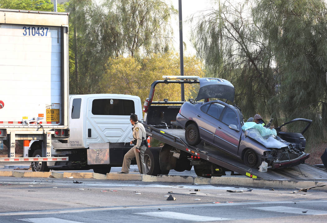 A car is being towed away after being involved in an accident with a semitrailer, left, at the corner of Spencer Street and Serene Avenue on Wednesday, August 8, 2018. Bizuayehu Tesfaye/Las Vegas ...