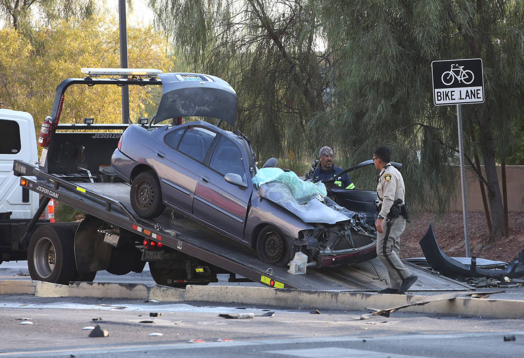 A car is being towed away after being involved in an accident with a semitrailer at the corner of Spencer Street and Serene Avenue on Wednesday, August 8, 2018. Bizuayehu Tesfaye/Las Vegas Review- ...