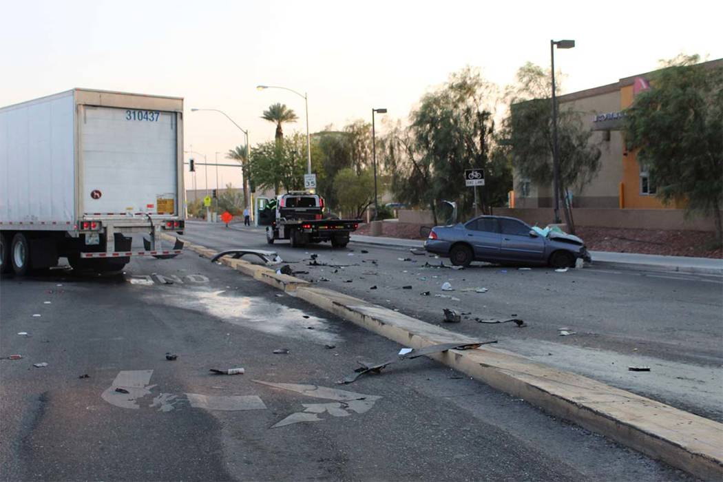 One person was critically injured when a sedan and a semitrailer collided Wednesday, August 8, 2018, at the corner of Spencer Street and Serene Avenue. (Max Michor/Las Vegas Review-Journal)